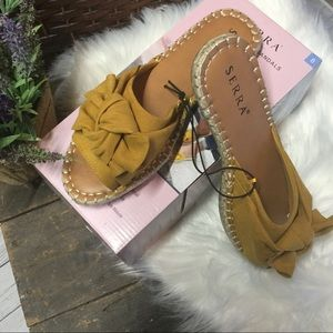 Shoes - NWT. Cute bow tie sandals in marigold.